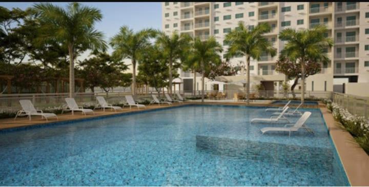 The swimming pool at or near Apartamento Pleno