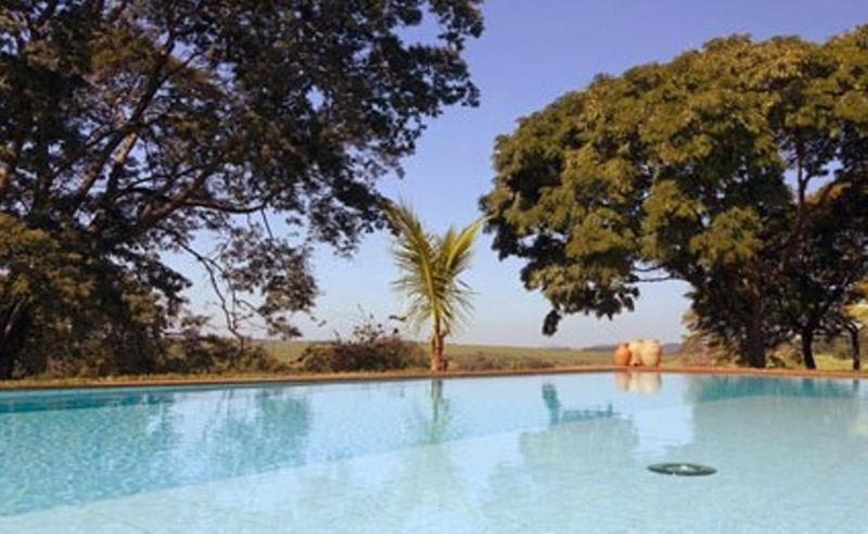 A piscina localizada em Fazenda Santa Teresa Hotel & SPA ou nos arredores