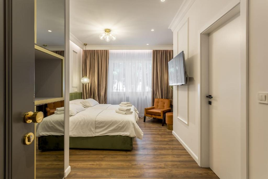 A bed or beds in a room at Nephelae Boutique Rooms