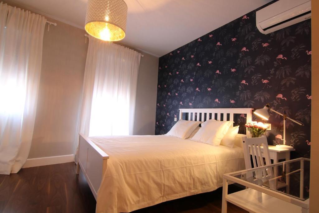 Cama o camas de una habitación en La Fonda de Candeleda