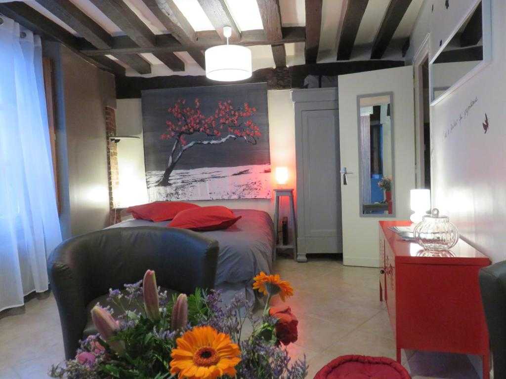 A bed or beds in a room at Studio Adulaire et Spinelle
