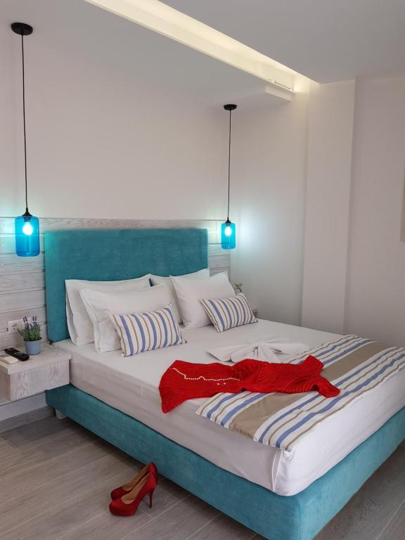A bed or beds in a room at Metsikas Residence
