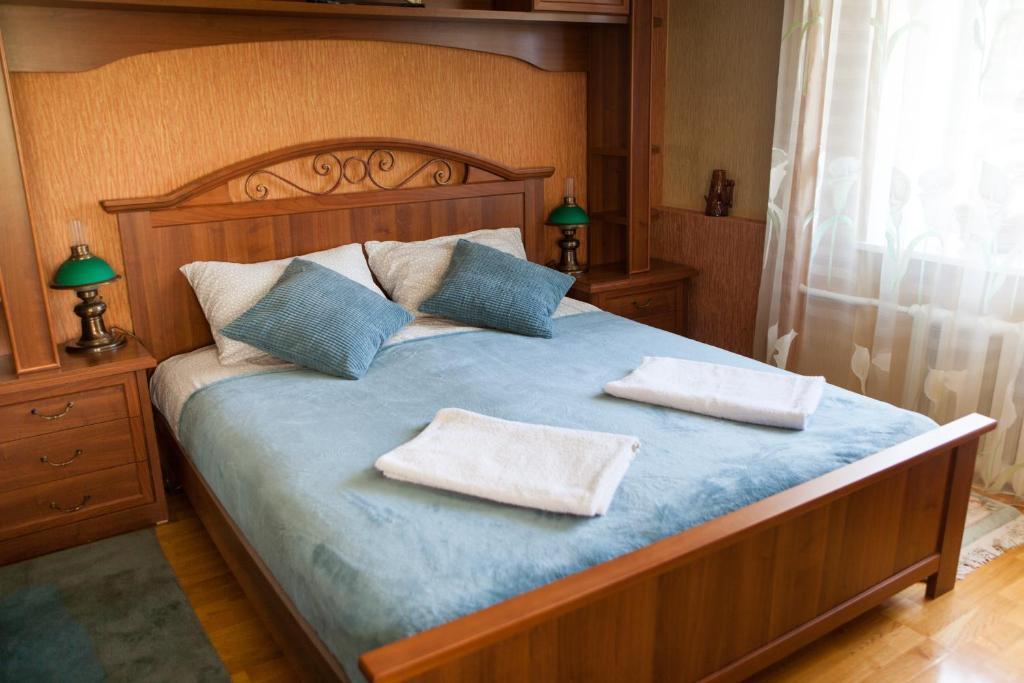 A bed or beds in a room at Дом в Казанской Швейцарии