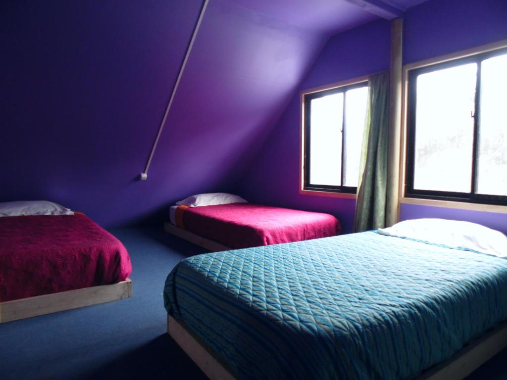 A bed or beds in a room at Cahuin Hostel