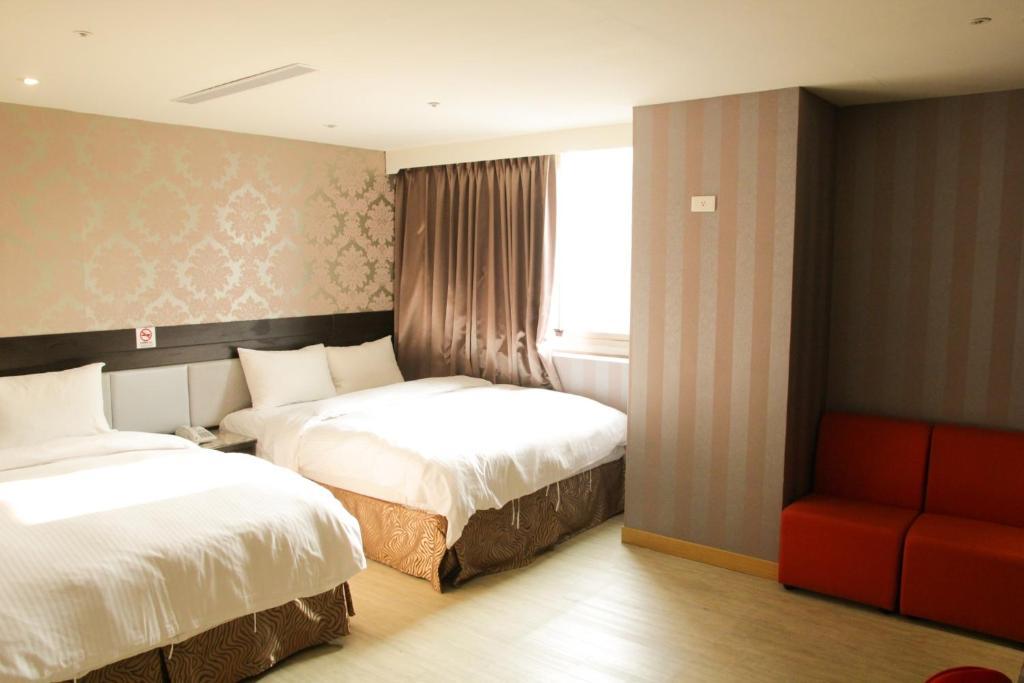 מיטה או מיטות בחדר ב-E Hotel