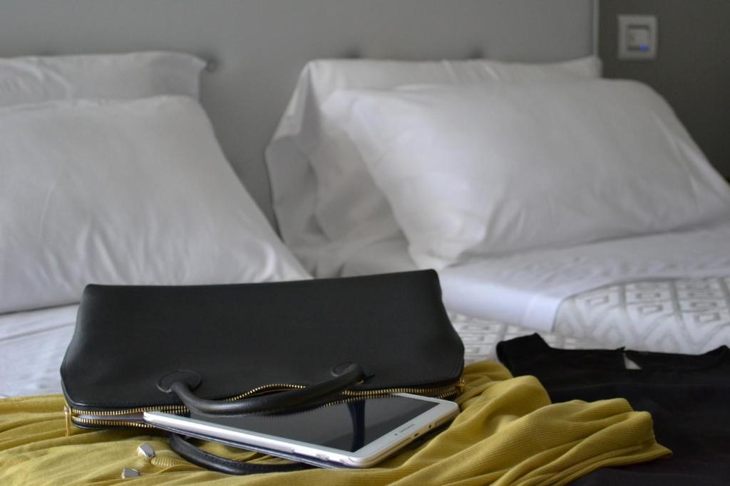 Un pat sau paturi într-o cameră la Hotel Panorama