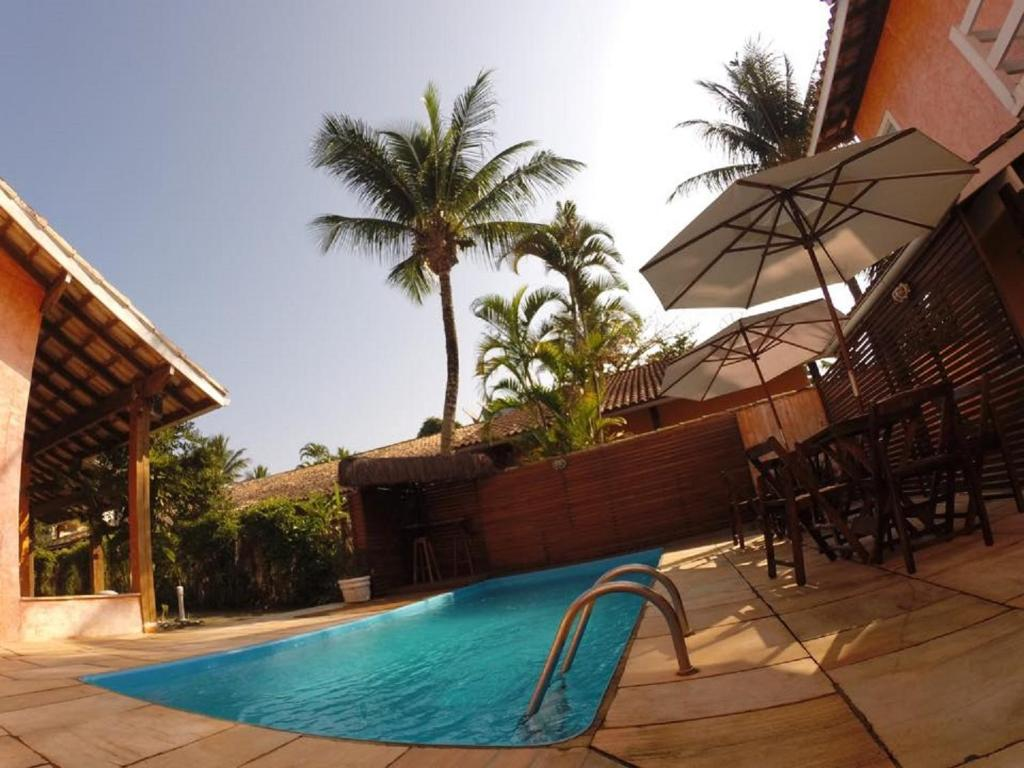 The swimming pool at or near Pousada Pantai Maresias