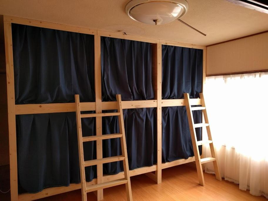 A bunk bed or bunk beds in a room at Stay@Kushiro