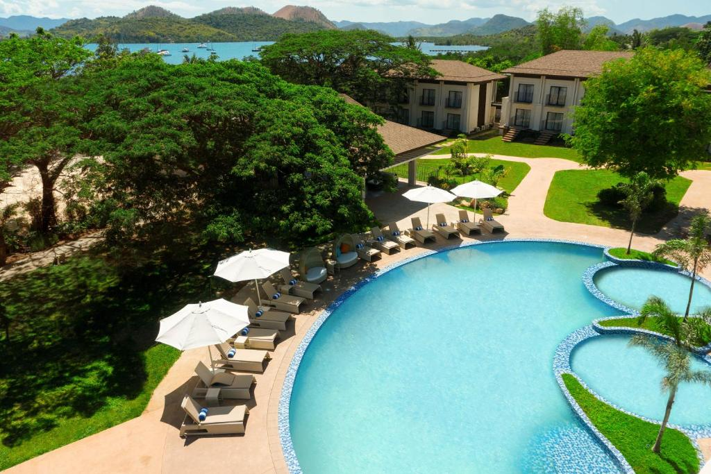 A view of the pool at Bacau Bay Resort Coron or nearby