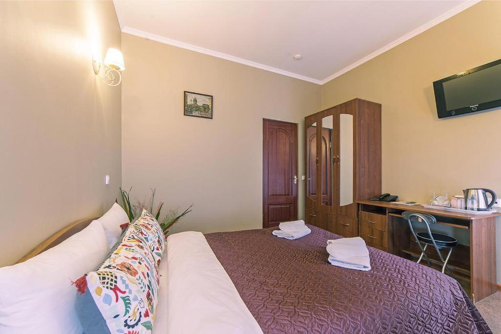 Кровать или кровати в номере Мини Отель Аничков Мост