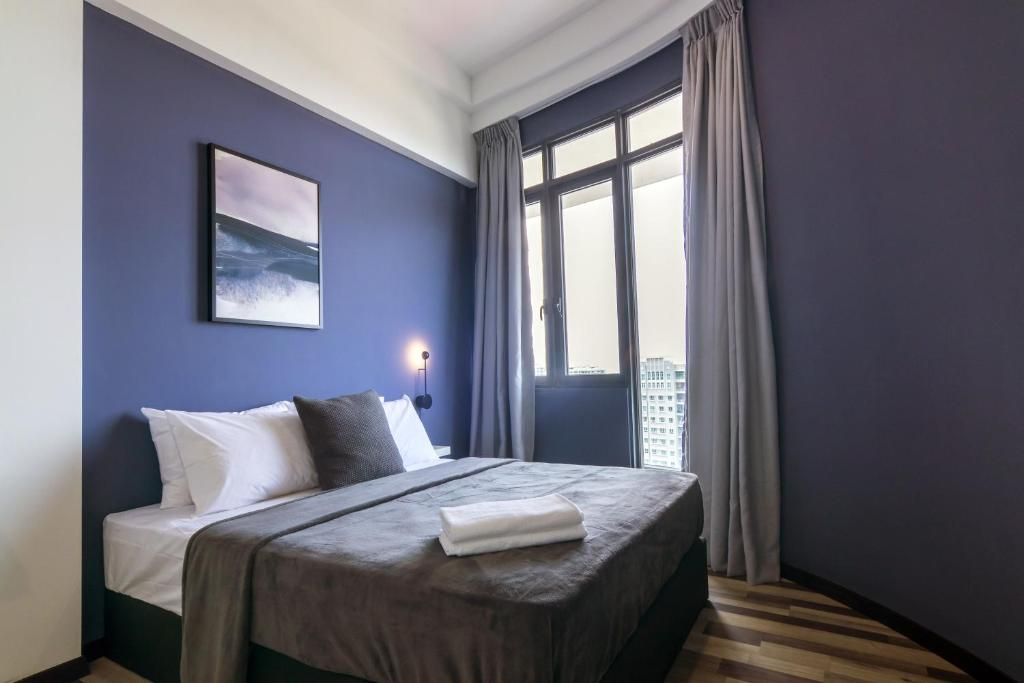 A bed or beds in a room at Arte Serviced Apartment @ Penang