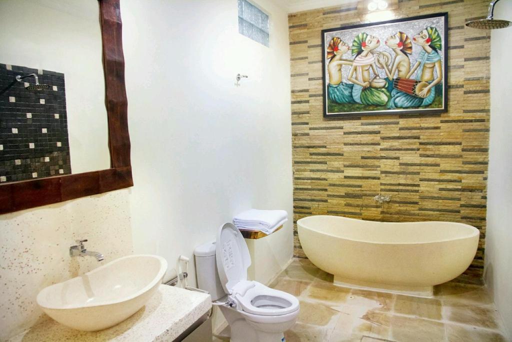 Ein Badezimmer in der Unterkunft Maha Residence Guest House