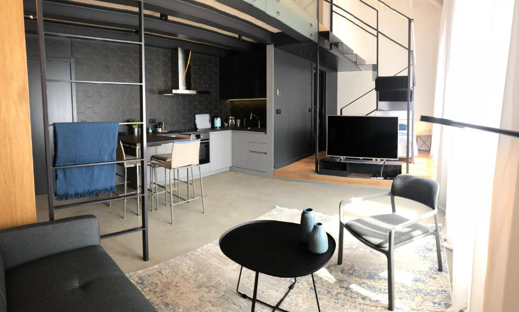 A television and/or entertainment centre at The Bridge Casa Luxury Apartments