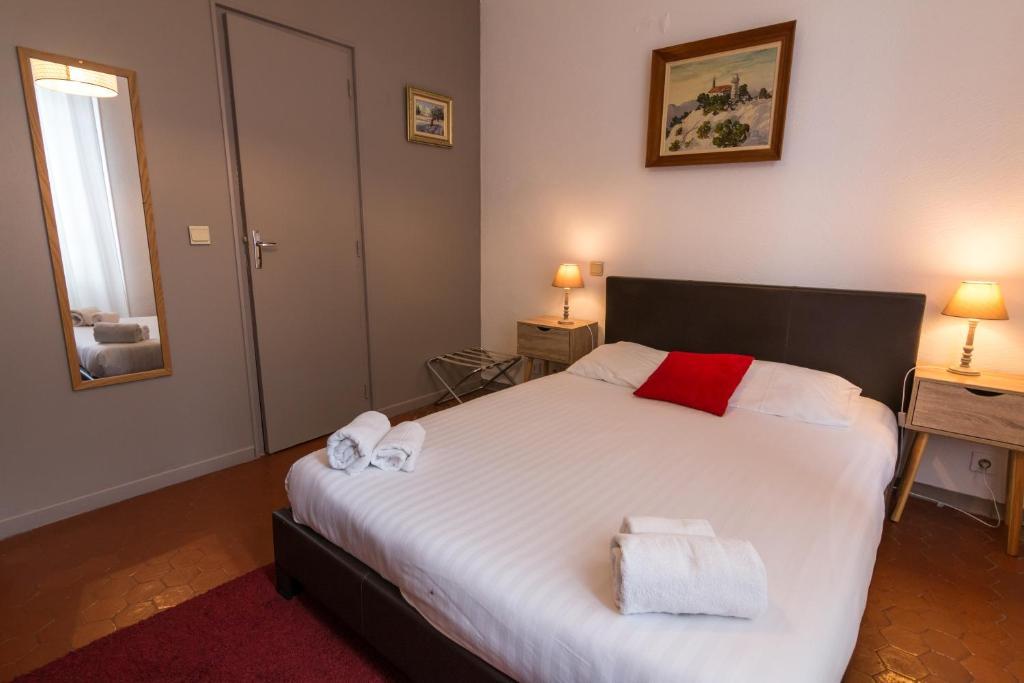 Un ou plusieurs lits dans un hébergement de l'établissement Ma Petite Auberge