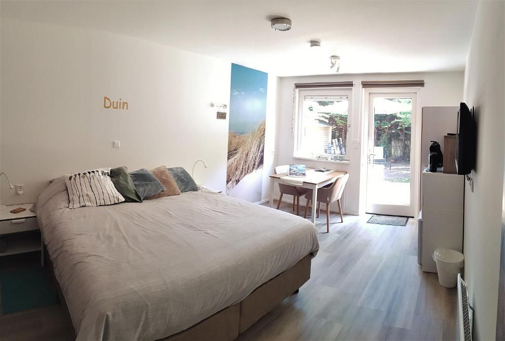 Ein Bett oder Betten in einem Zimmer der Unterkunft Duin en Zee Texel