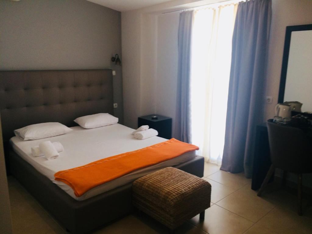 A bed or beds in a room at Minos Hotel