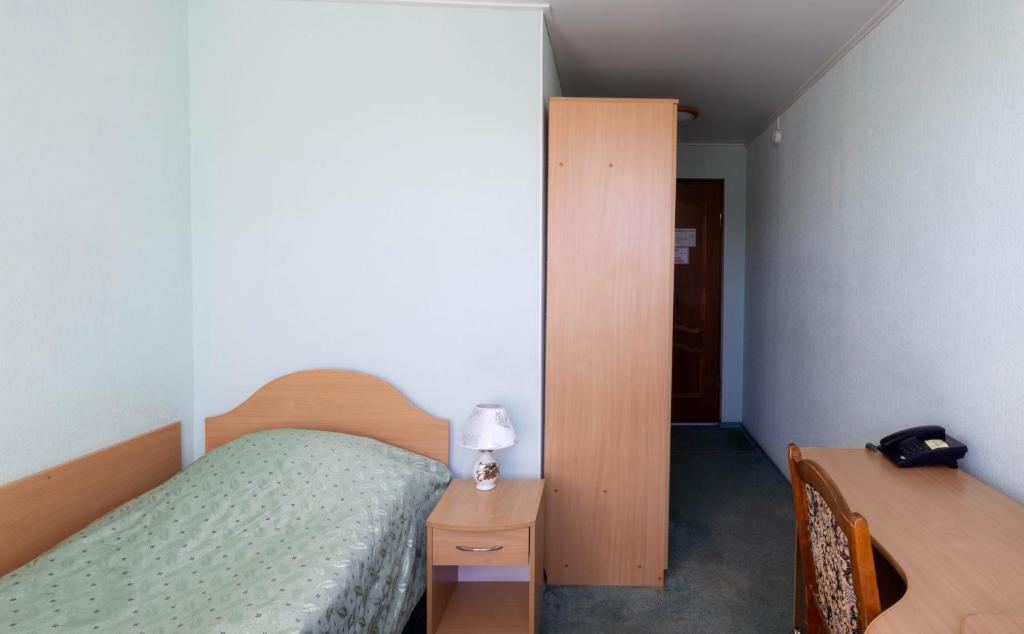 A bed or beds in a room at Leningrad Hotel