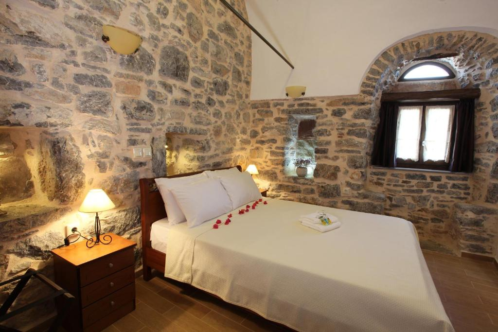 Ein Bett oder Betten in einem Zimmer der Unterkunft STOES Traditional Suites