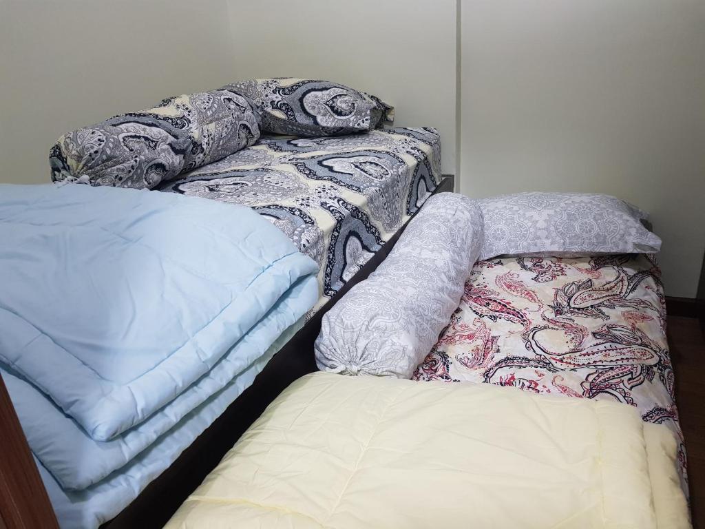 A bed or beds in a room at KVA Syariah 2BR 1211