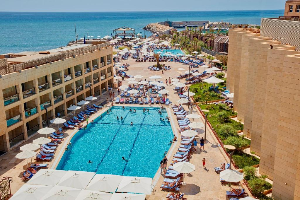 A view of the pool at Coral Beach Hotel And Resort Beirut or nearby