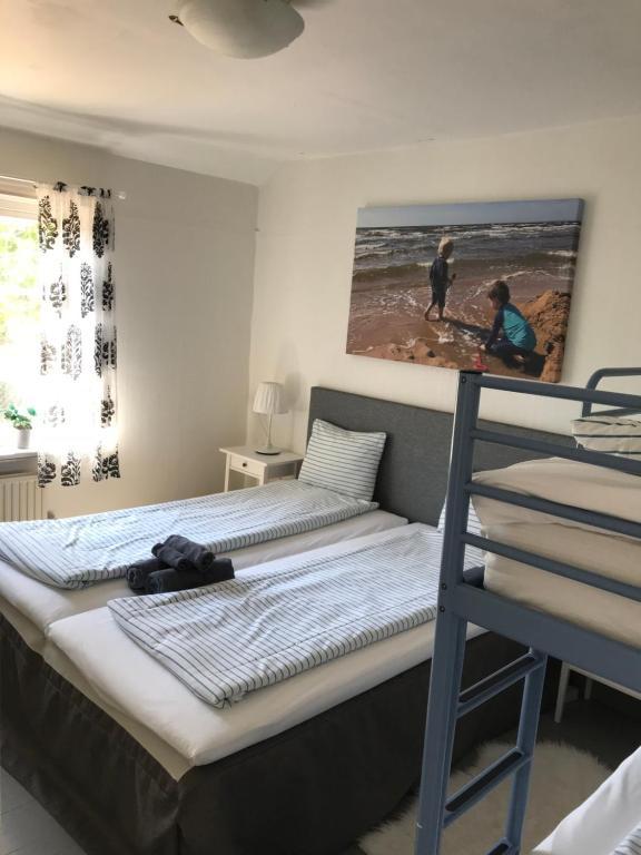 Säng eller sängar i ett rum på Hallandsgården Mellbystrand