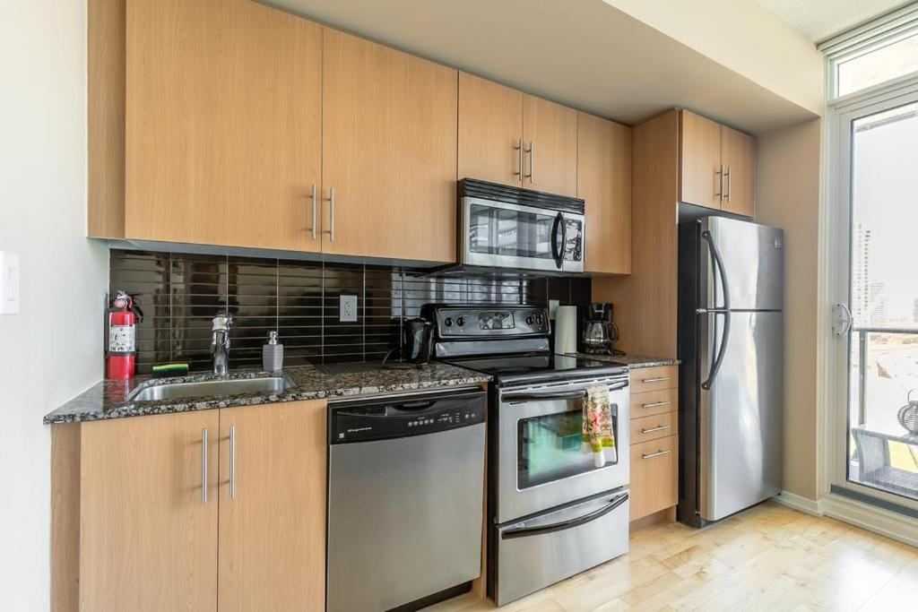 A kitchen or kitchenette at Luxury Furnished Corporate Suite in Downtown Toronto