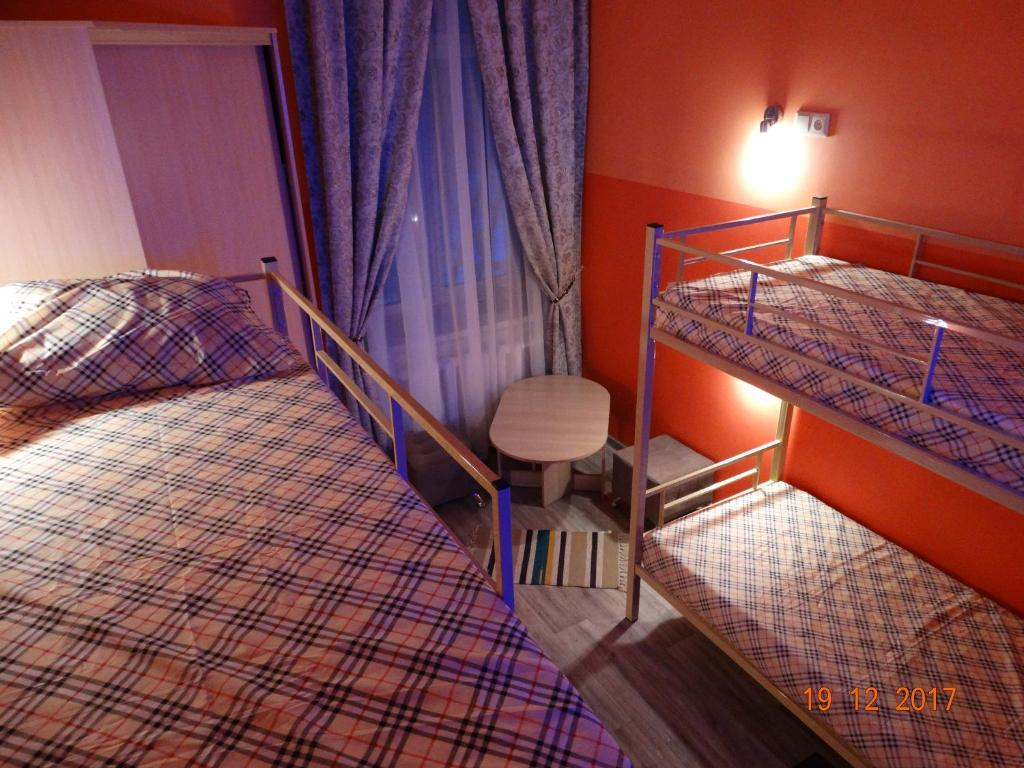 A bunk bed or bunk beds in a room at Valday Hostel