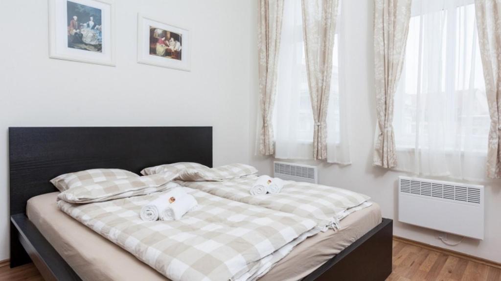 Ένα ή περισσότερα κρεβάτια σε δωμάτιο στο All4you Apartments