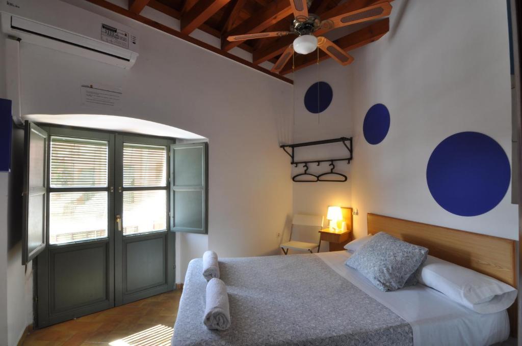 Cama o camas de una habitación en Hostel La Corredera
