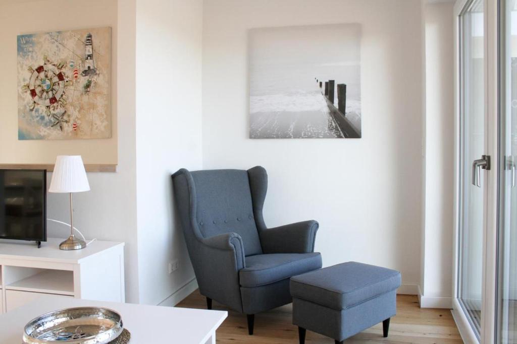 Ein Sitzbereich in der Unterkunft Haus an den Salzwiesen - Wohnung Sturmmöwe