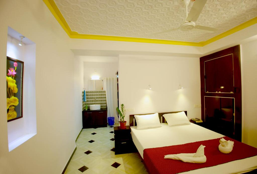 A bed or beds in a room at MARARI GOD's OWN VILLA