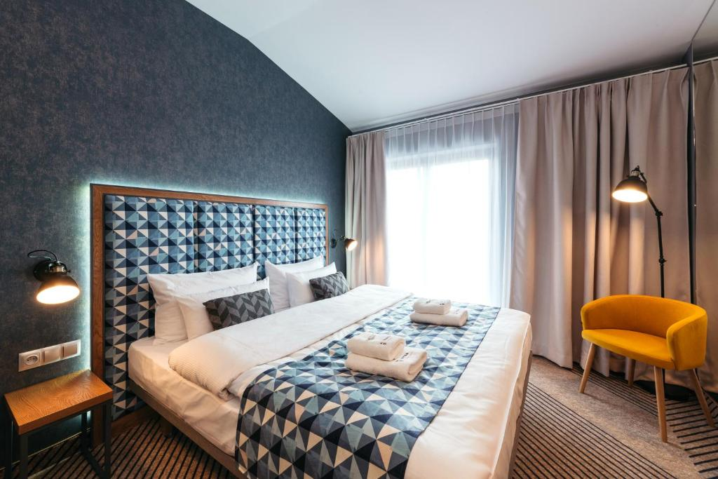 A bed or beds in a room at Avena by Artery
