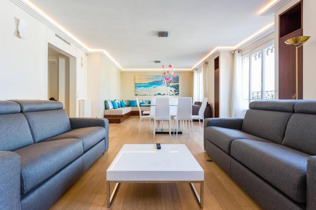 Ein Sitzbereich in der Unterkunft CMG Luxury Marais