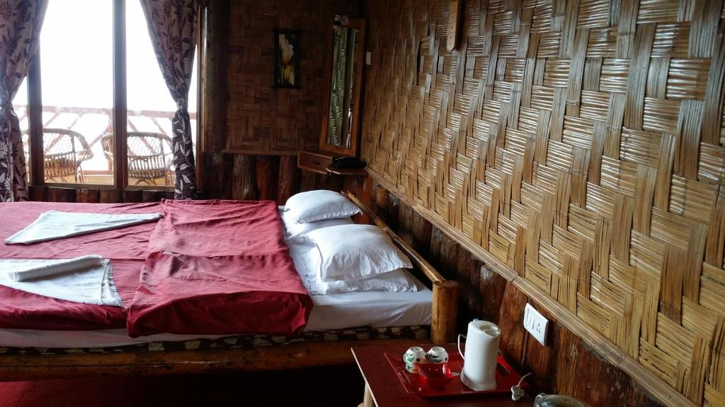 A bed or beds in a room at Hilltop Rabong Resort