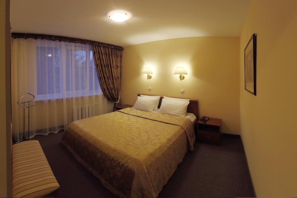 Кровать или кровати в номере Гостиница Садко