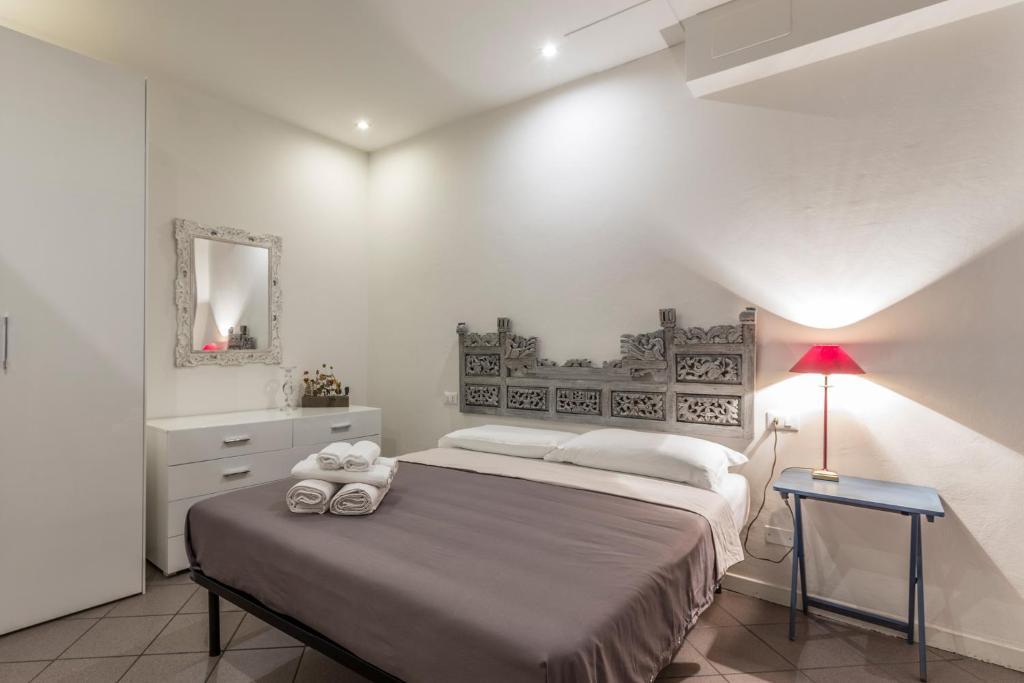 Letto o letti in una camera di Farini Love - The Place Apartments