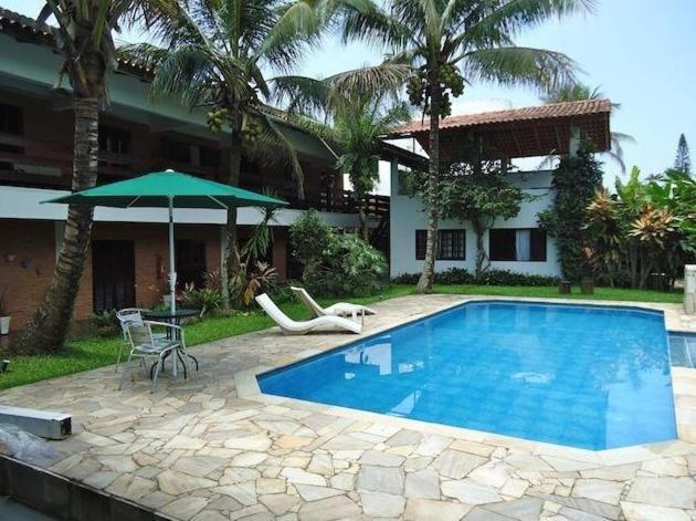 The swimming pool at or near Pousada Mari