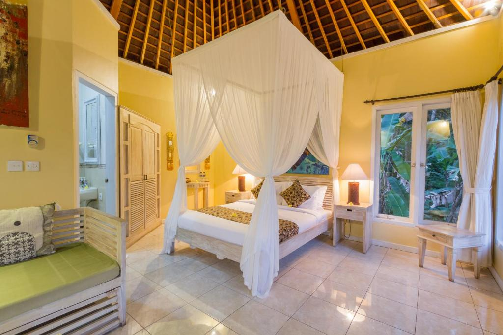 A bed or beds in a room at Bali Eco Adventure & Retreat Center