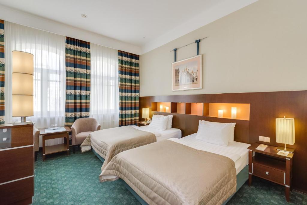 Кровать или кровати в номере Петр 1