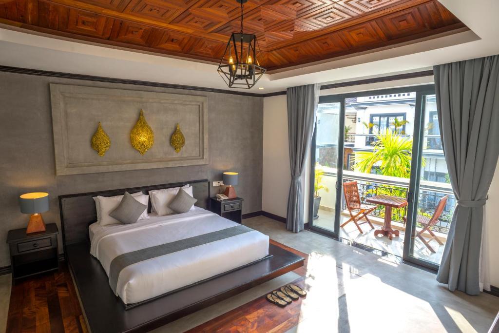 Un ou plusieurs lits dans un hébergement de l'établissement Udaya Residence