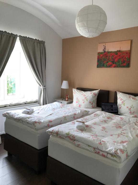 Ein Bett oder Betten in einem Zimmer der Unterkunft Living Apart Leipzig