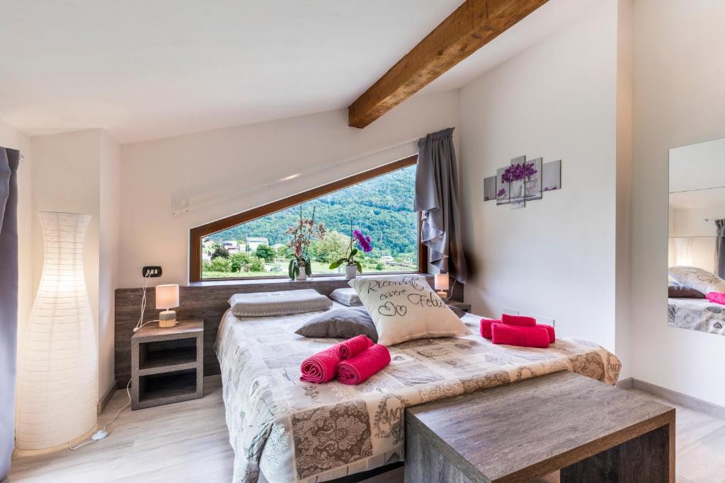 Letto o letti in una camera di Valtellina Mon Amour
