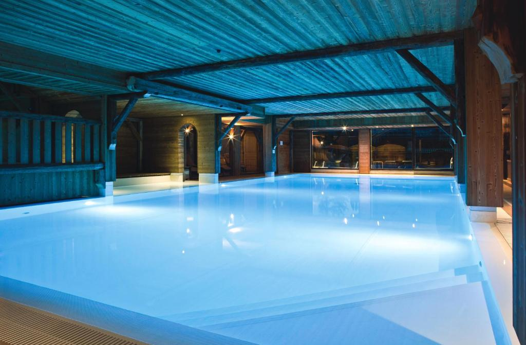The swimming pool at or close to Chalet-Hôtel La Marmotte, La Tapiaz & SPA, The Originals Relais (Hotel-Chalet de Tradition)