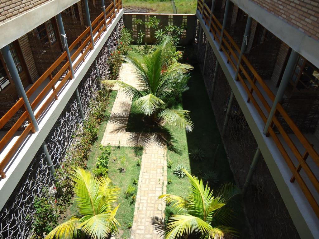 A view of the pool at Pousada Taieiras or nearby
