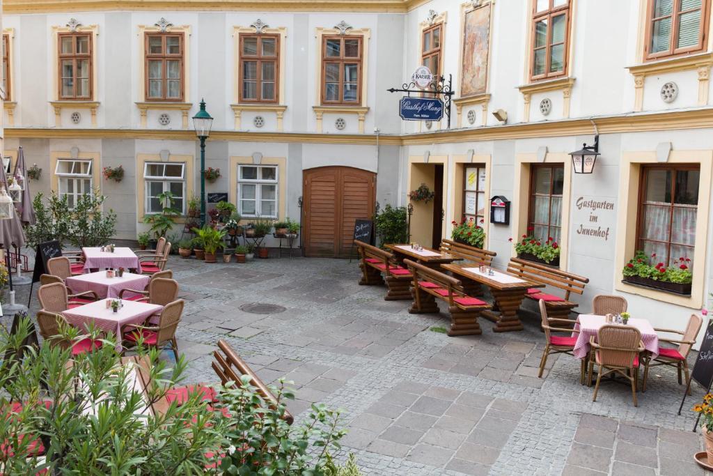 Ein Restaurant oder anderes Speiselokal in der Unterkunft Gasthof Mang