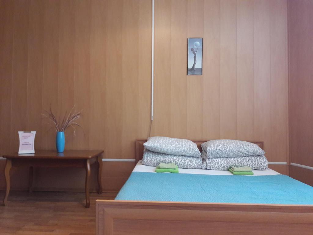 Кровать или кровати в номере BM Hostel V. Novgorod