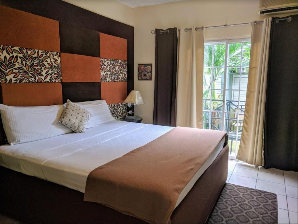 A bed or beds in a room at Christar Villas Hotel