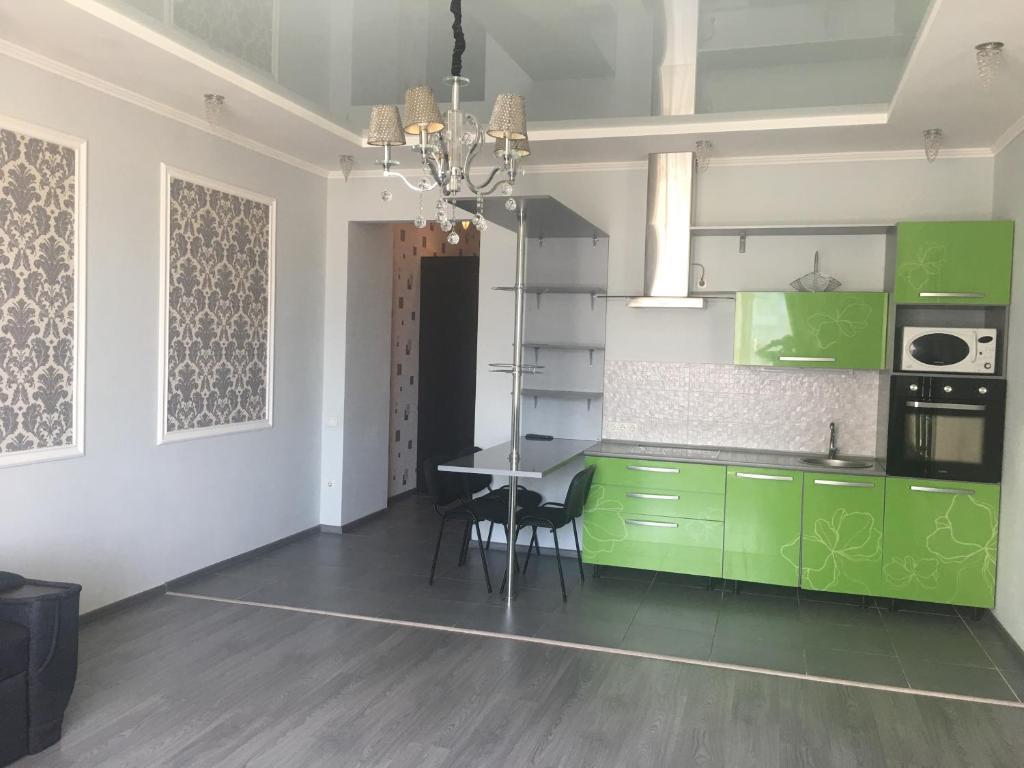 Кухня или мини-кухня в Уютный центр