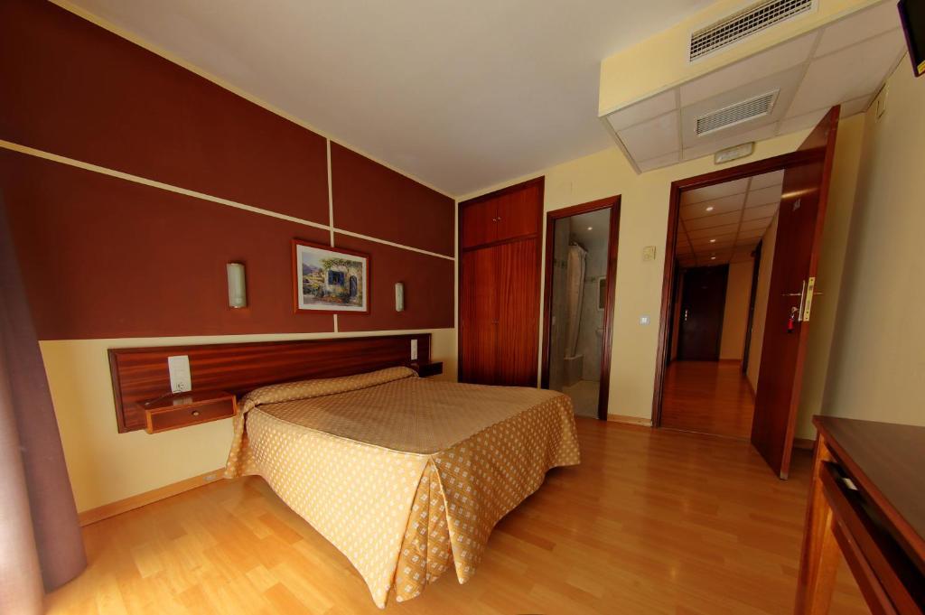 Cama o camas de una habitación en Hotel Ollé