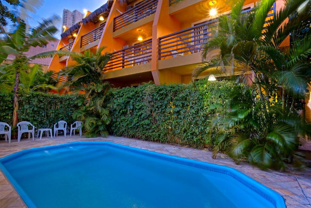 A piscina localizada em Apart Hotel Casa Grande ou nos arredores